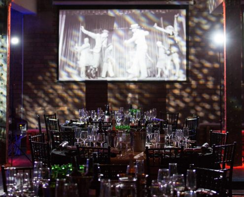 Event Design with tables, chairs and wine glasses