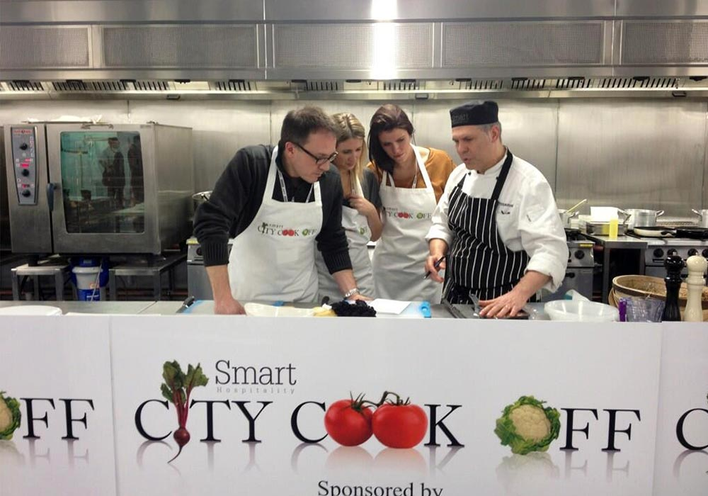 Group of people cooking with a professional chef