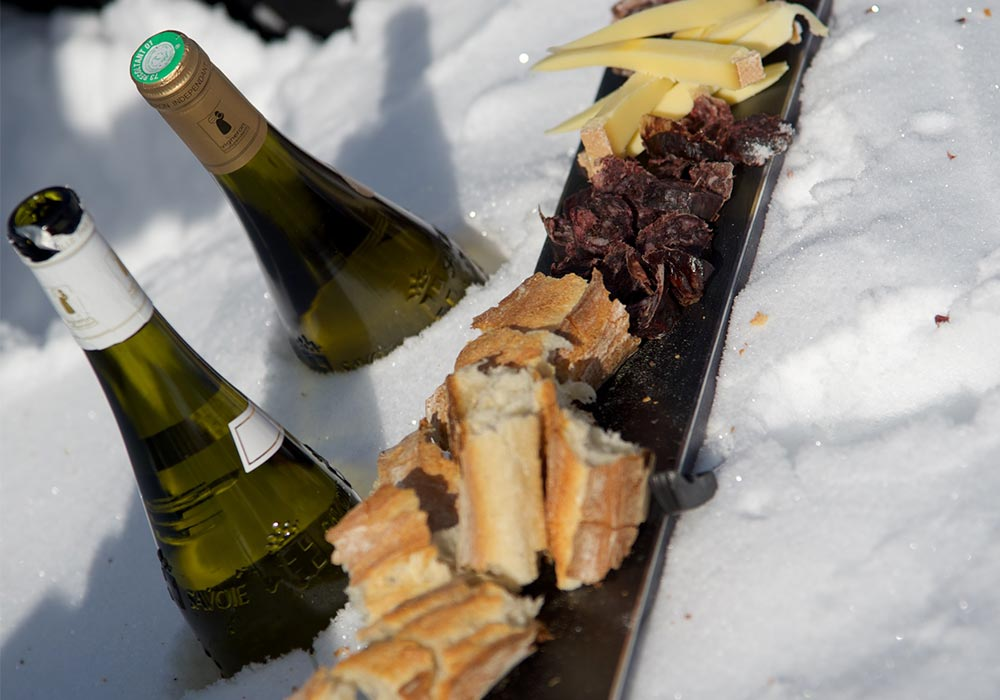Ice cold wine bottle in the snow with canopy food